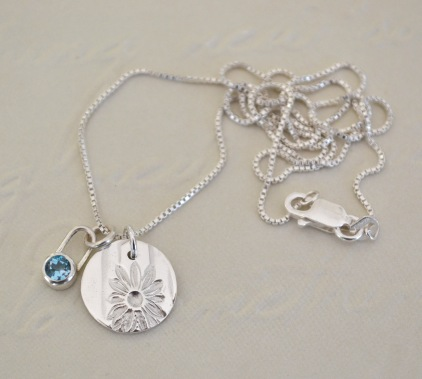 Sterling Silver and Mid Blue Topaz Daisy Token Necklace
