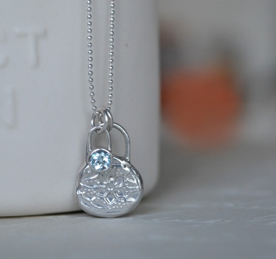 Sterling Silver and Sky Blue Topaz Floral Relic Pendant