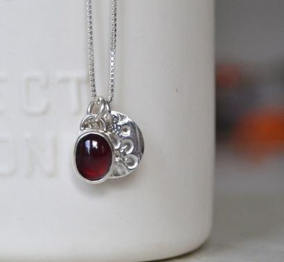 Sterling Silver and Almandine Garnet Floral Token Necklace