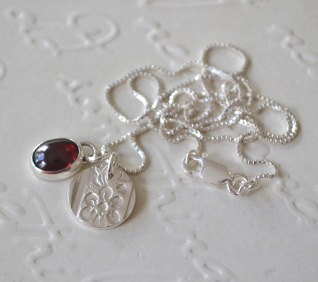 Sterling Silver and Almandine Garnet Daisy Token Necklace